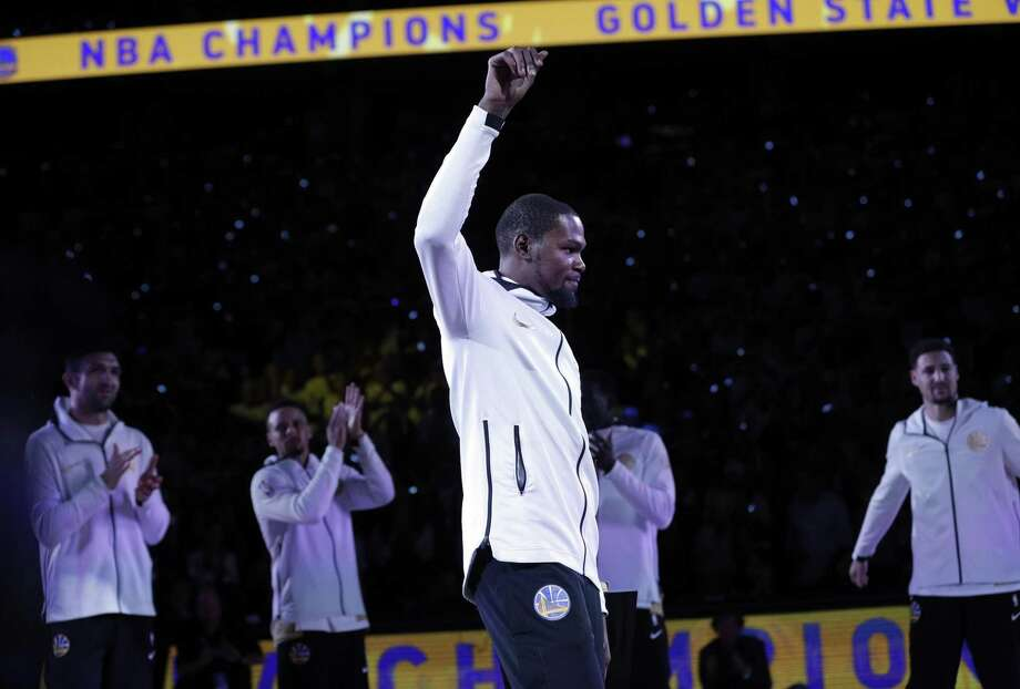 Kevin Durant acknowledges the crowd before getting his championship ring before the Warriors played the Houston Rockets on opening night. Photo: Carlos Avila Gonzalez / The Chronicle / ONLINE_YES