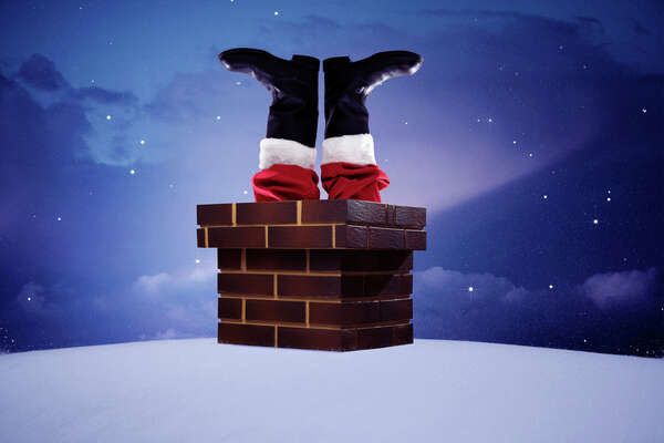 Traditional Santa Claus in a chimney