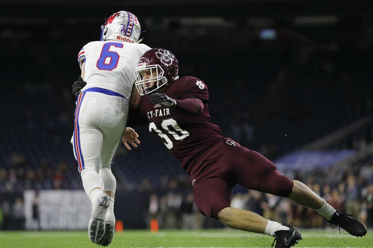 Cy-Fair Bobcats Patrick Atkinson (C) (30) stops Austin Westlake Chaparrals Taylor Anderson (6) for no gain near the goal line in the second quarter during the high school football semifinal playoff playoff game between the Austin Westlake Chaparrals and the Cy-Fair Bobcats at NRG Stadium in Houston, TX on Saturday, December 16, 2017.