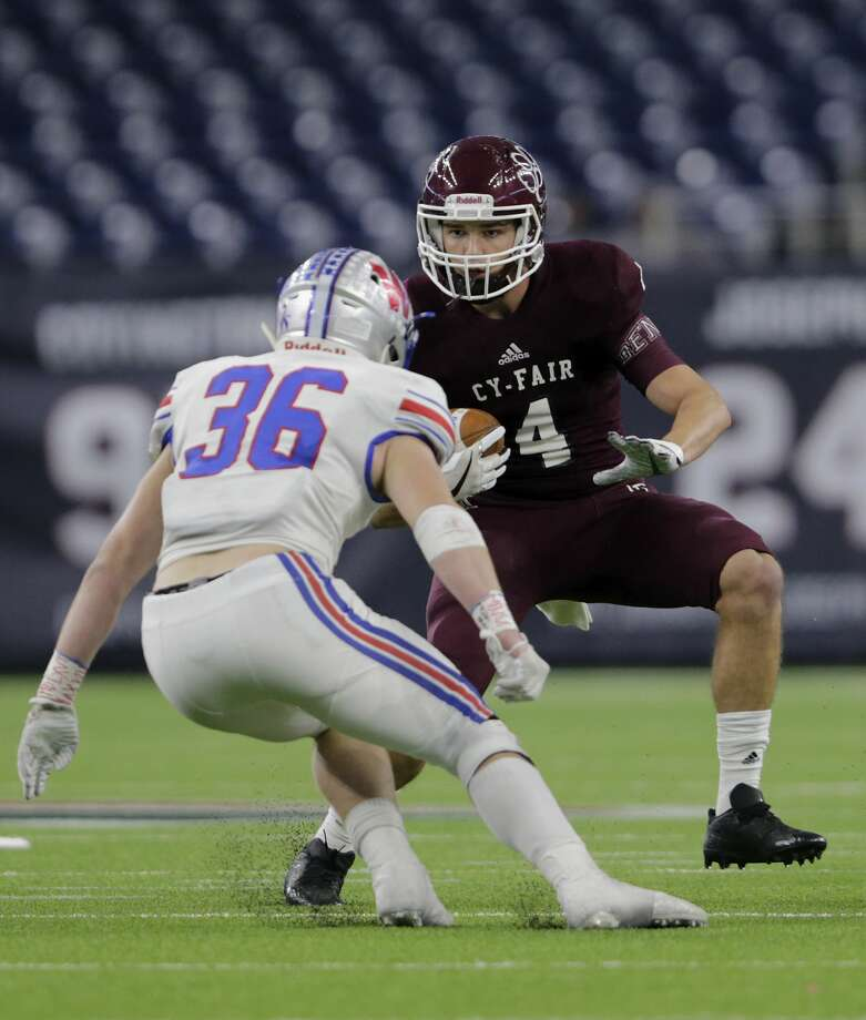 Cy-Fair Bobcats Jacob Farrell (4) runs after a catch defended by Austin Westlake Chaparrals Jake Ehlinger (36) during the high school football semifinal playoff playoff game between the Austin Westlake Chaparrals and the Cy-Fair Bobcats at NRG Stadium in Houston, TX on Saturday, December 16, 2017. Photo: Tim Warner/For The Chronicle