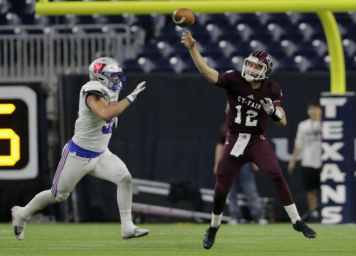 Quarterback Cam Arnold (12) is piling up statistics and big plays, a rarity for Cy-Fair, which typically leans on a powerful running game and stout defense to win important games.