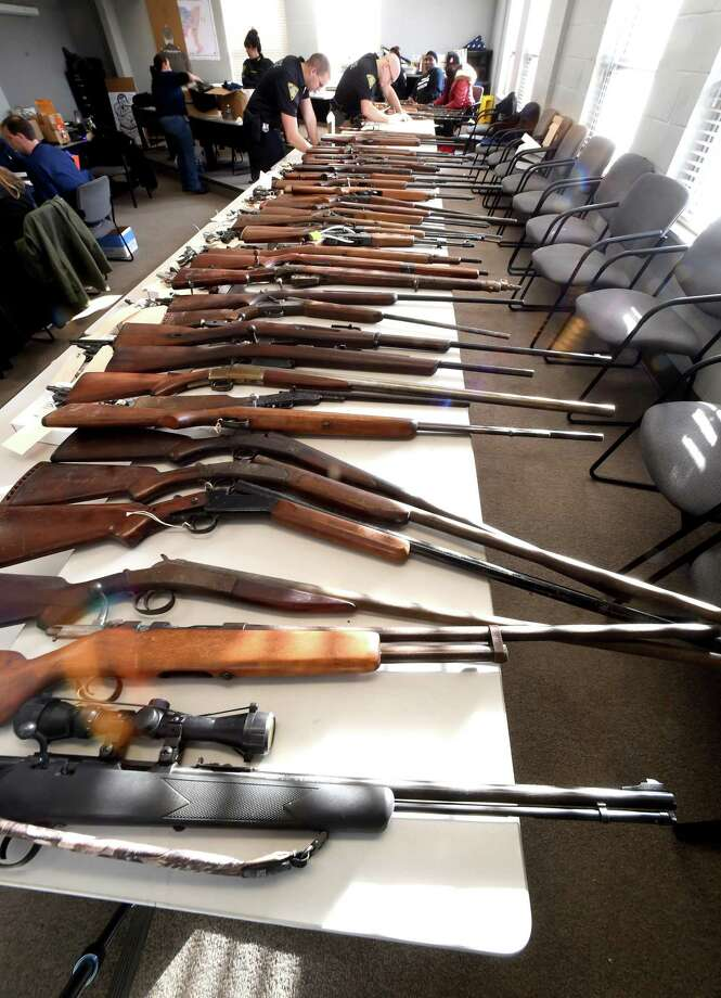 Guns brought in for a buy-back at the New Haven Police Academy in New Haven are catalogued on December 16, 2017. Photo: Arnold Gold / Hearst Connecticut Media / New Haven Register
