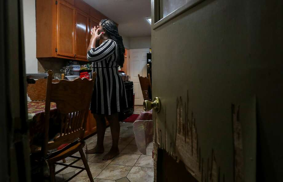 Lisa White, whose home flooded in August 2016, cries while talking about a local nonprofit that helped her rebuild her house. Photo: Jon Shapley