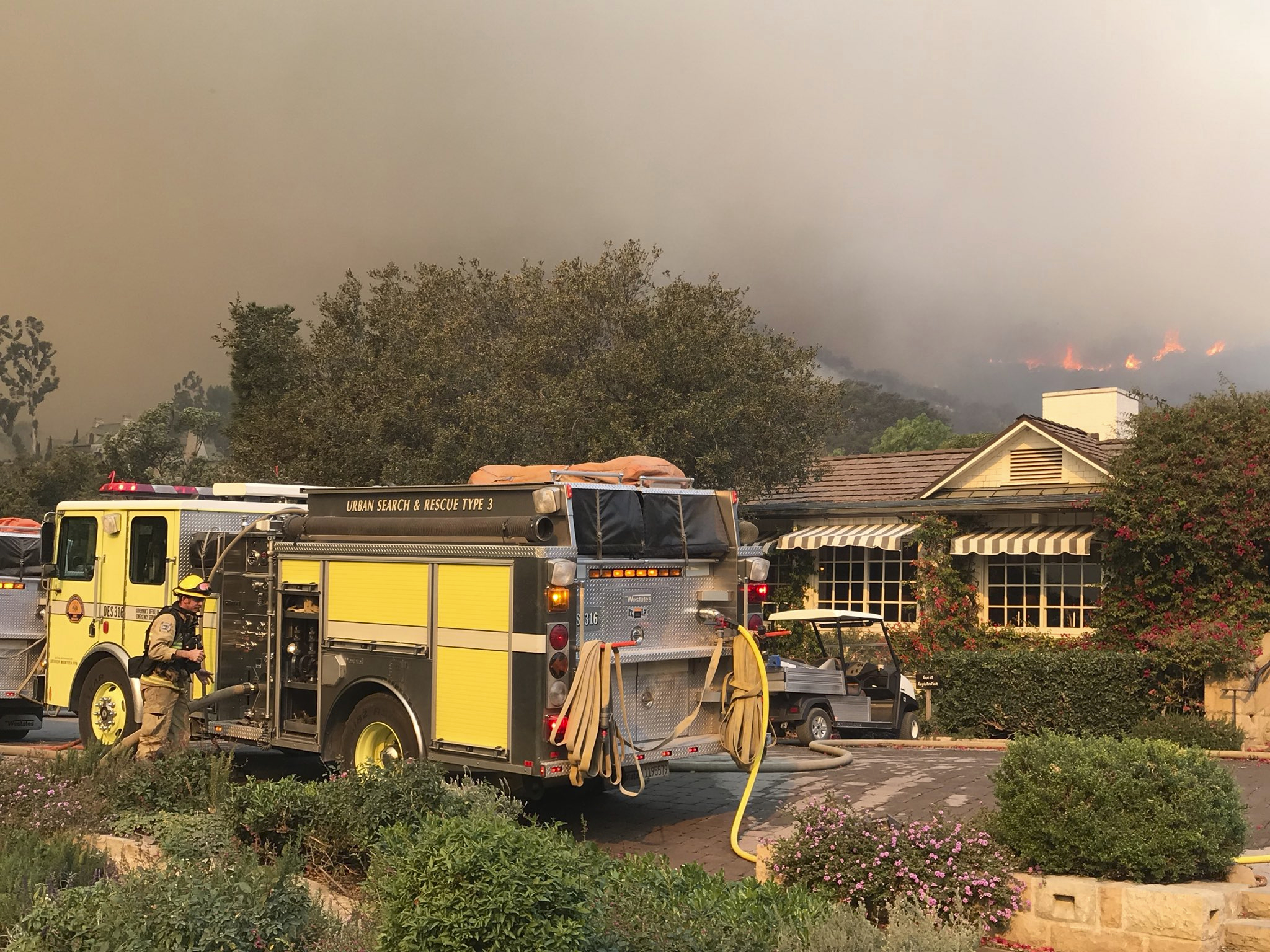 Residents flee as flames approach wealthy California enclave ...