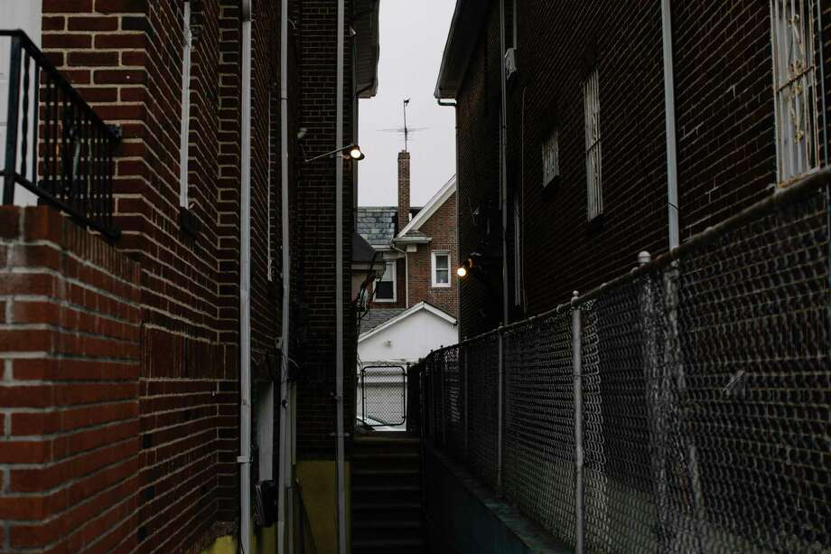The view down an alley off the Queens street where Nazi collaborator Jakiw Palij lives in New York. Must credit: Photo by Celeste Sloman for The Washington Post Photo: Celeste Sloman, For The Washington Post / Celeste Sloman