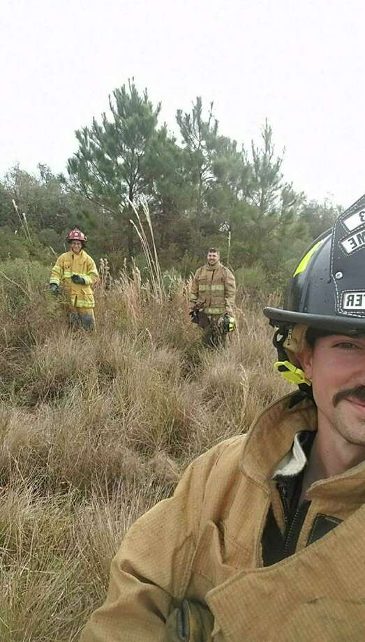 Jefferson County Emergency Services District No. 3 and No. 1 firefighters pose together for a smiling selfie after responding to two brush fires Saturday. Photo: Jefferson County Emergency Services District No. 3