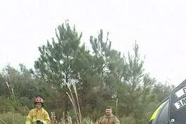 Jefferson County Emergency Services District No. 3 and No. 1 firefighters pose together for a smiling selfie after responding to two brush fires Saturday.