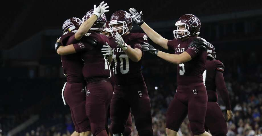 PHOTOS: A look at Cy-Fair's state semifinal win over Austin WestlakeCy-Fair Bobcats Cam Arnold (C) (12), Jacob Farrell (4), Ryan Nelub (5), and Graham Lakin (70) celebrate after the high school football semifinal playoff playoff game between the Austin Westlake Chaparrals and the Cy-Fair Bobcats at NRG Stadium in Houston, TX on Saturday, December 16, 2017. Photo: Tim Warner/For The Chronicle