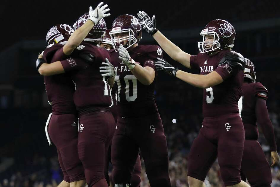 Cy-Fair Bobcats Cam Arnold (C) (12), Jacob Farrell (4), Ryan Nelub (5), and Graham Lakin (70) celebrate after the high school football semifinal playoff playoff game between the Austin Westlake Chaparrals and the Cy-Fair Bobcats at NRG Stadium in Houston, TX on Saturday, December 16, 2017.