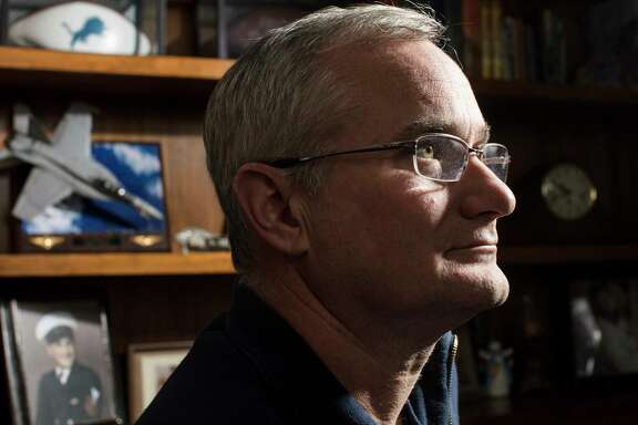 """Cmdr. David Fravor, a retired Navy pilot, at home in Windham, N.H., Dec. 8, 2017.  Fravor's encounter with an unidentified aircraft of some kind — whitish — that was around 40 feet long and oval in shape, over the Pacific while on a training mission in 2004 caught the attention of a Pentagon program investigating UFOs. """"It accelerated like nothing I've ever seen,"""" Fravor said. He was, he said, """"pretty weirded out.""""  (M. Scott Brauer/The New York Times)"""