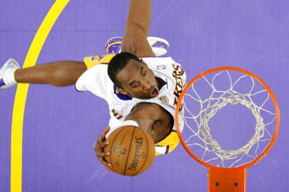 Lakers guard Kobe Bryant dunks in a home game against the Orlando Magic on Dec. 2, 2007. The 2007-08 season was Bryant's only MVP campaign, when he averaged 28.3 points per game.