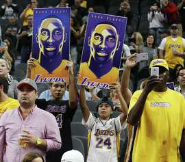 Lakers fans show their support for Kobe Bryant (24) before the game against the Spurs at the AT&T Center on Friday, Dec. 11, 2015. (Kin Man Hui/San Antonio Express-News)