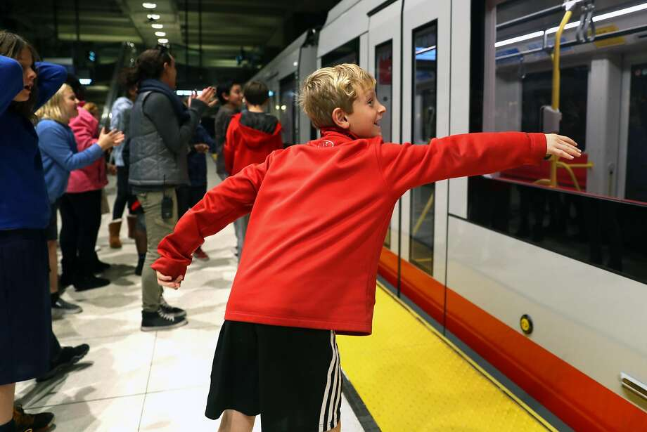 Noah Lantsberg, 10, tries to touch a train during a field trip to familiarize After School Enrichment Program 5th graders with the MUNI system. Photo: Scott Strazzante, The Chronicle
