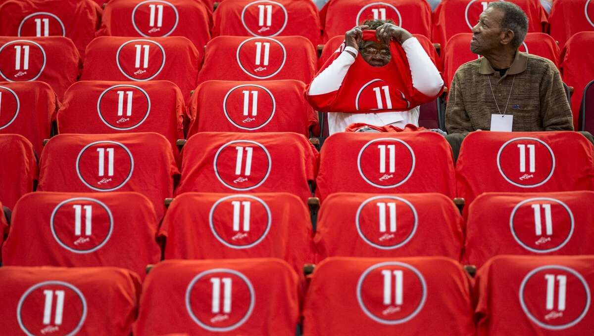 Rosie Beverley, left, and Elroy Beverley, Jr., Houston Rockets guard Patrick Beverley's great-grandparents, sit surrounded by t-shirts honoring center Yao Ming before an NBA basketball game against the Chicago Bulls at Toyota Center on Friday, Feb. 3, 2017, in Houston. The Rockets are retiring Yao's jersey number 11 during a halftime ceremony.