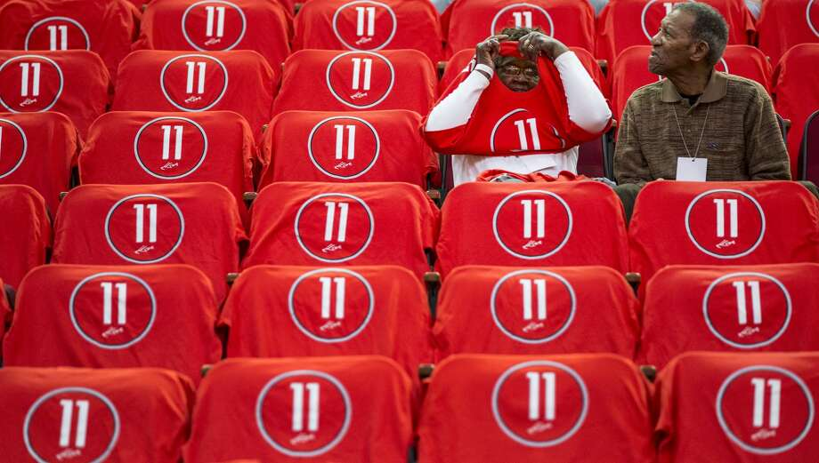 Rosie Beverley, left, and Elroy Beverley, Jr., Houston Rockets guard Patrick Beverley's great-grandparents, sit surrounded by t-shirts honoring center Yao Ming before an NBA basketball game against the Chicago Bulls at Toyota Center on Friday, Feb. 3, 2017, in Houston. The Rockets are retiring Yao's jersey number 11 during a halftime ceremony. Photo: Brett Coomer/Houston Chronicle