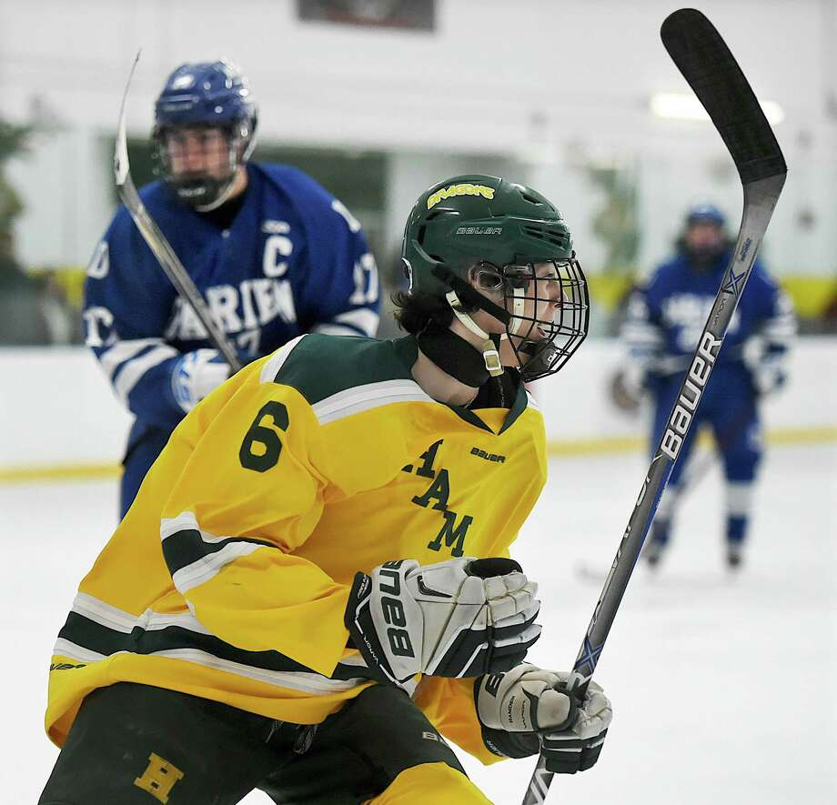 Hamden's Tyler Routh celebrates after scoring his second goal against Darien on Saturday at Astorino Rink in Hamden. Photo: Catherine Avalone / Hearst Connecticut Media / New Haven Register