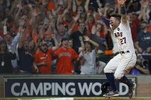 Houston Astros Jose Altuve reacts after tagging home to score the winning run on Carlos Correa's walk off double in the ninth inning of Game 2 of the ALCS at Minute Maid Park on Saturday, Oct. 14, 2017, in Houston.
