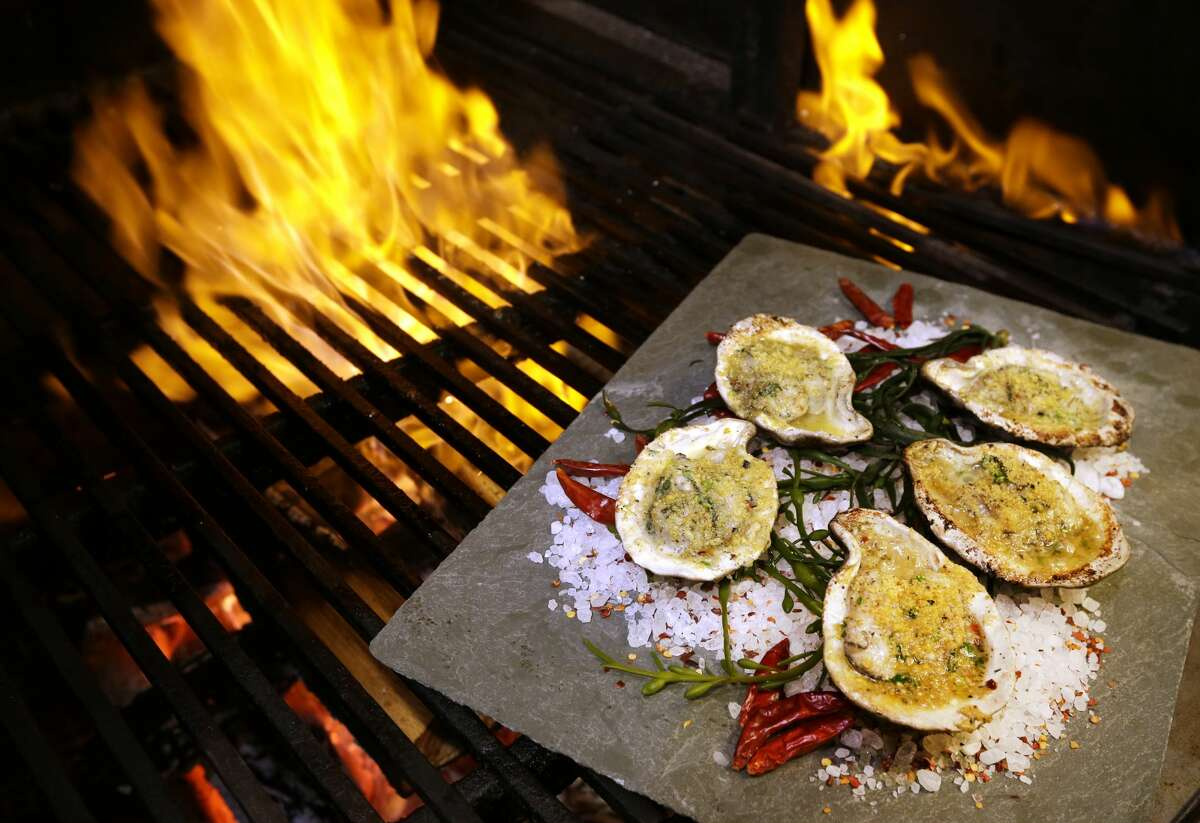Jimmy's Wood Grilled Oysters prepared by Danny Trace, executive chef at Brennan's of Houston, 3300 Smith, are shown Thursday, Feb. 23, 2017, in Houston.