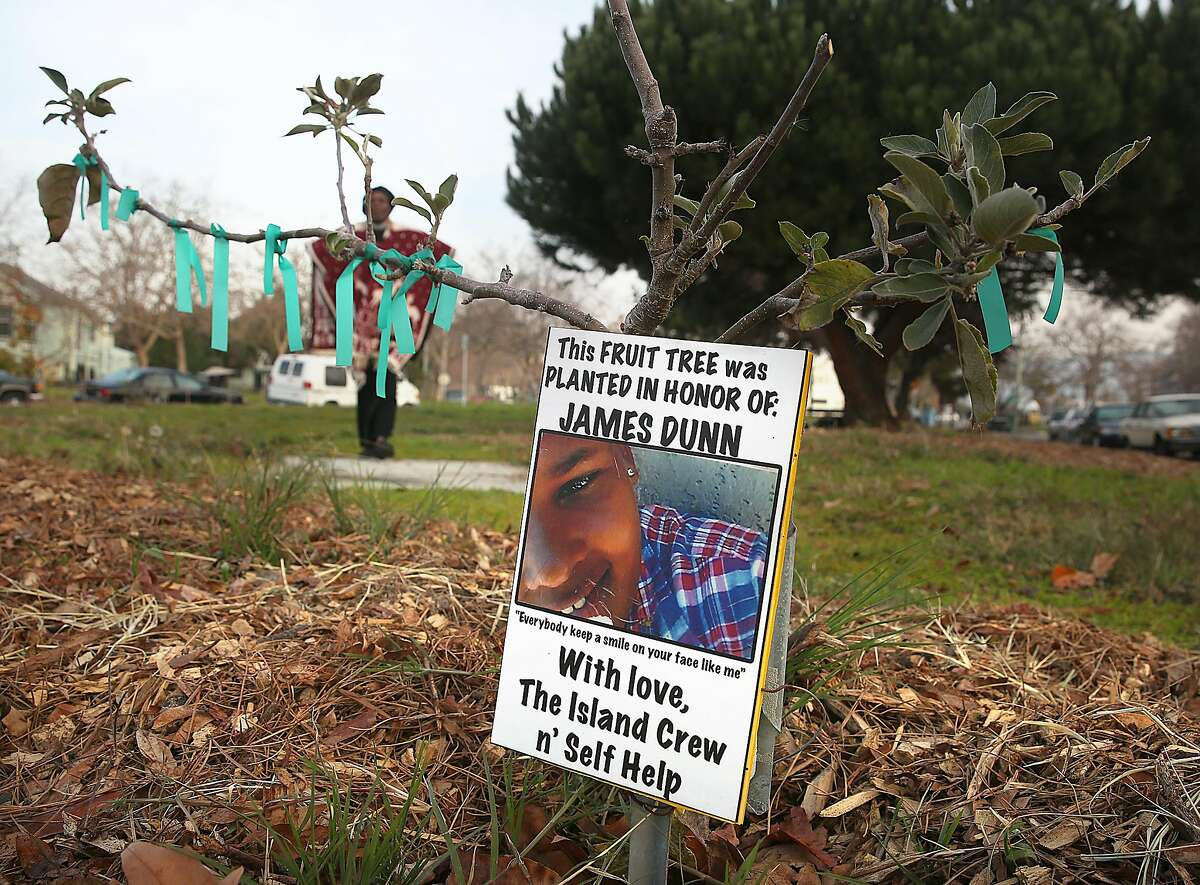 Community leader Frances Moore feeds people in Driver Plaza next to this park as part of the Self Help Hunger Program and also helped create a community garden where a fruit tree was planted in honor of James Dunn, a young neighbor and supporter of the park and hunger program on Friday, December 15, 2017, in Oakland, CA.