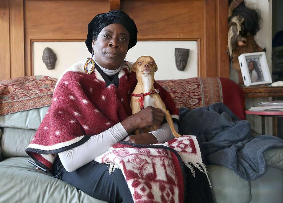 Community leader Frances Moore, and former member of the Black Panthers, at home with her dog. Photo: Liz Hafalia, The Chronicle