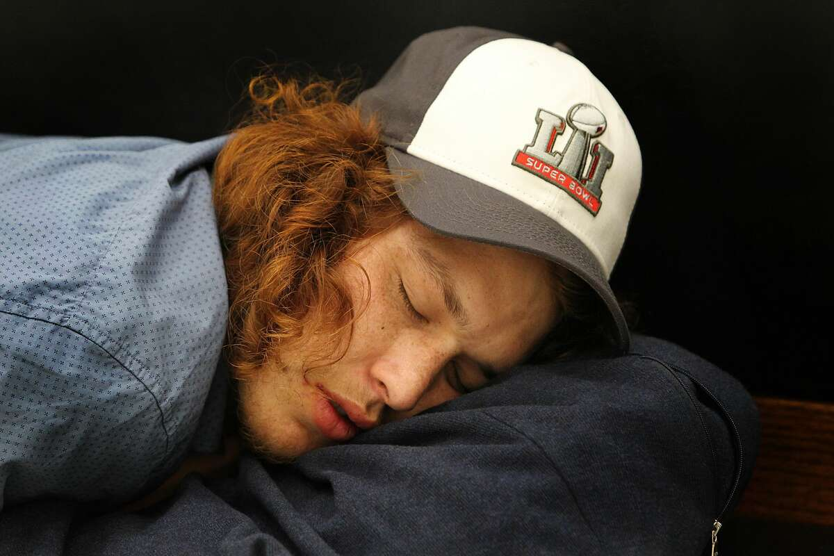Cory Derman, San Diego, California, catches up on sleep at Bush International Airport after pulling an all nighter. Derman and his friend went to the Super Bowl and stayed up until they arrived at IAH early Monday, Feb. 6, 2017, in Houston. Their flight is scheduled to depart at 10 p.m. tonight.