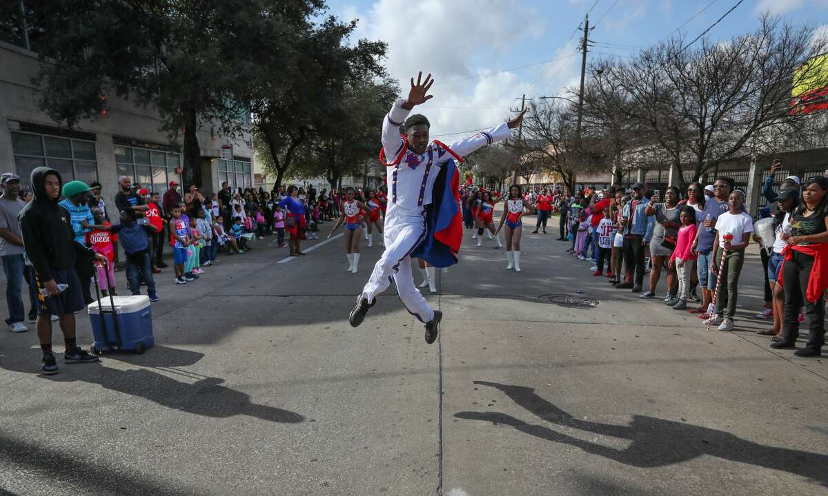 Zach Johnson, a senior at Kashmere High School, leads the school?'s participants in the 23rd MLK Grande Parade in Houston. The annual parade, which featured 15 floats and 30 marching bands, kicked off an exciting period for Houston, which would host its third Super Bowl three weeks later.