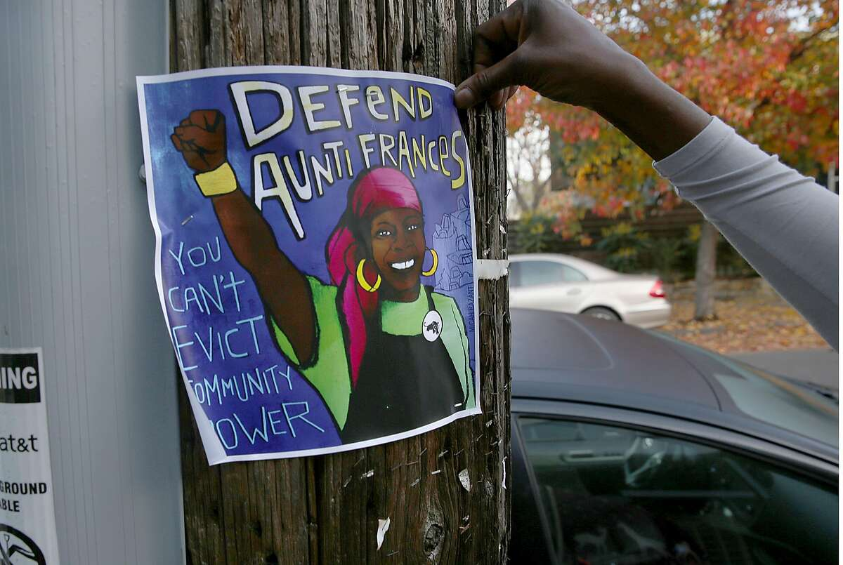 Neighbors placed posters on poles and in windows in support of community leader Frances Moore, former member of the Black Panthers, on Friday, December 15, 2017, in Oakland, CA.