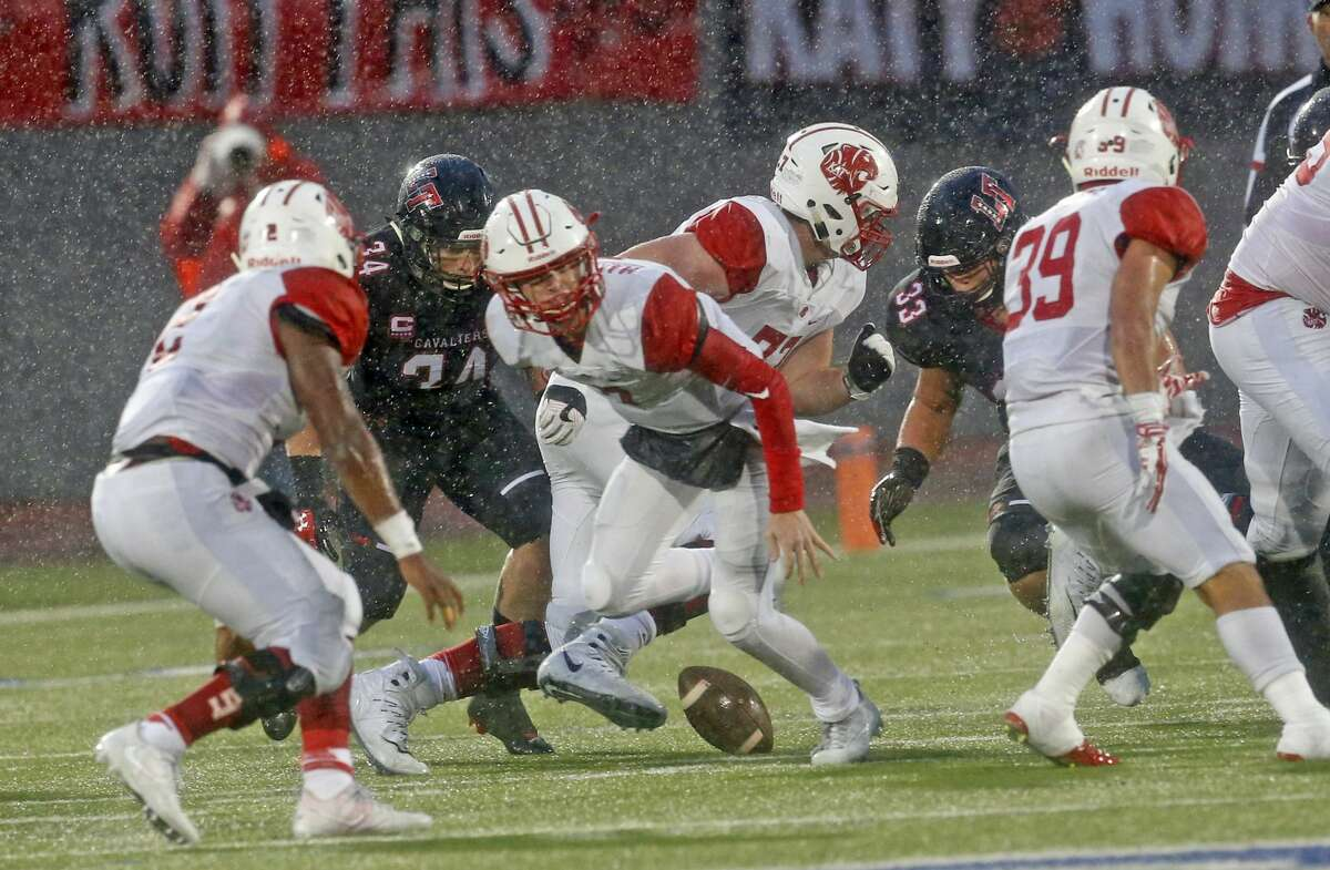 Katys?' Austin Marshall rolls out but fumble the ball. Katy football game against Lake Travis in the semifinals of the Class 6A, Division I football playoffs on Saturday, December 16, 2017 at Alamo Stadium.