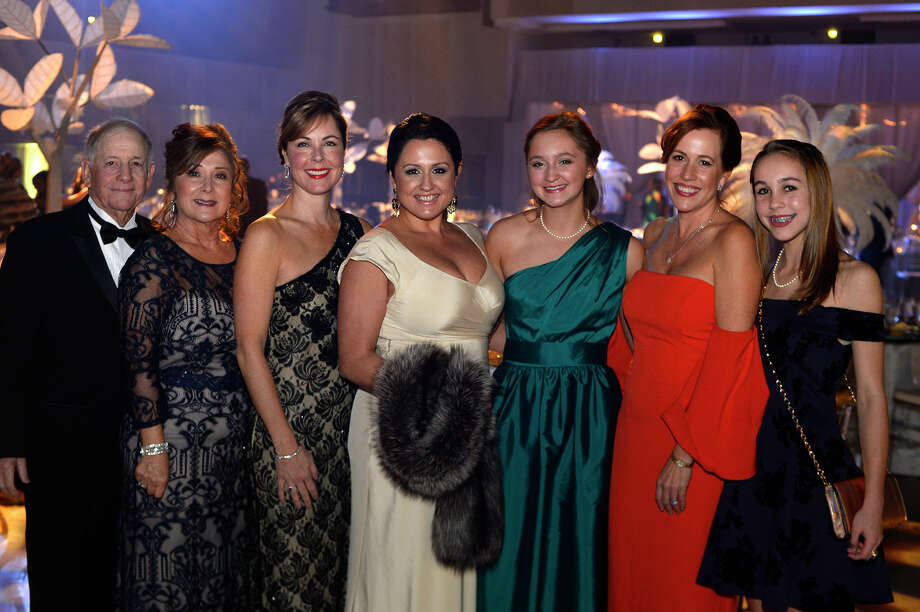 From left: Robert Marino, Terri Cash, Ellen Phelan, Sarah Frasher, Ellie Burns, Monica and Josie Broussard at the Symphony League of Beaumont's annual ball at the Beaumont Civic Center on Saturday night. The event provides support for the League and the Symphony of Southeast Texas.  Photo taken Saturday 12/16/17 Ryan Pelham/The Enterprise Photo: Ryan Pelham / ©2017 The Beaumont Enterprise/Ryan Pelham