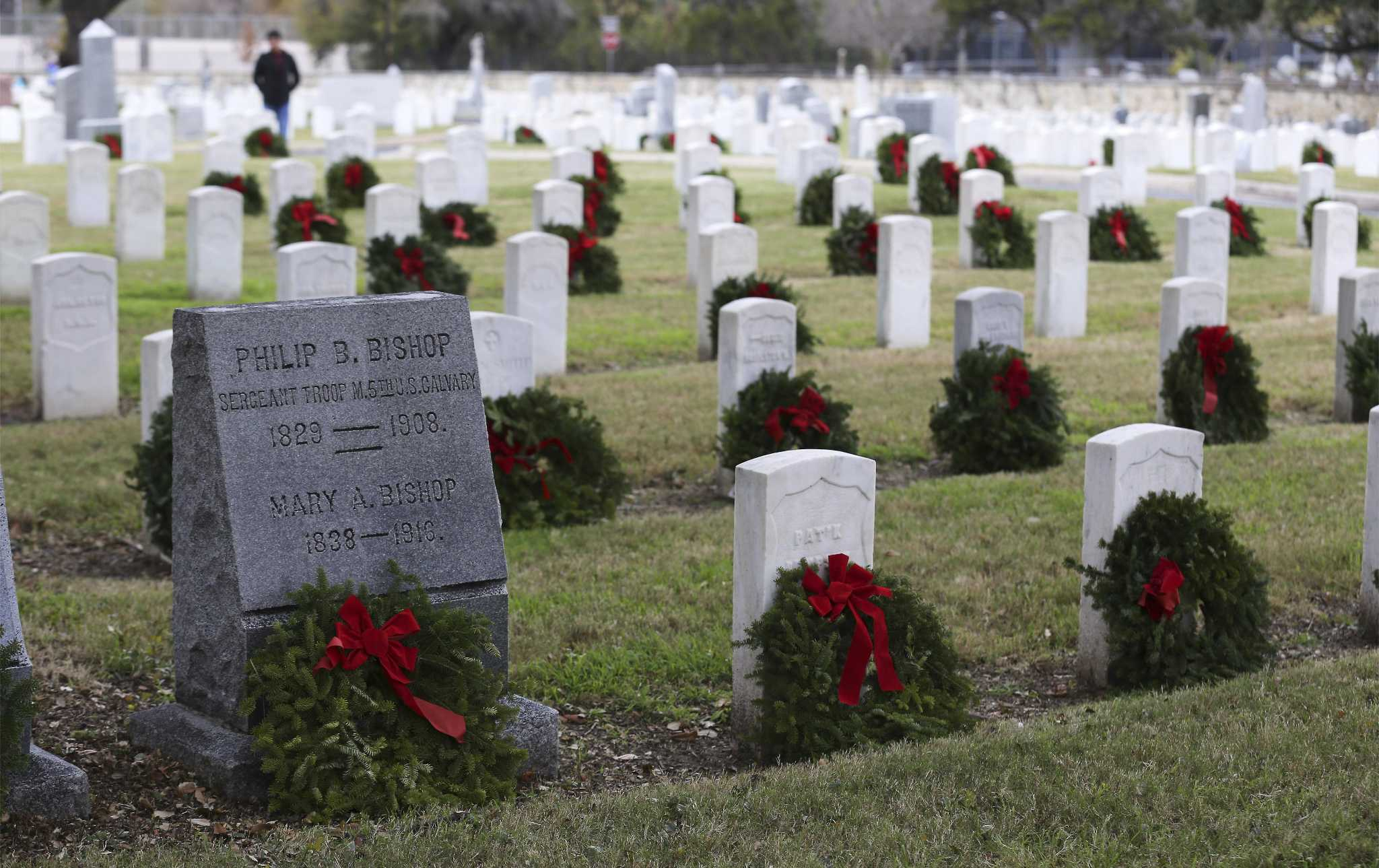 Volunteers gathered at two national cemeteries in San Antonio to lay wreaths on veterans' graves
