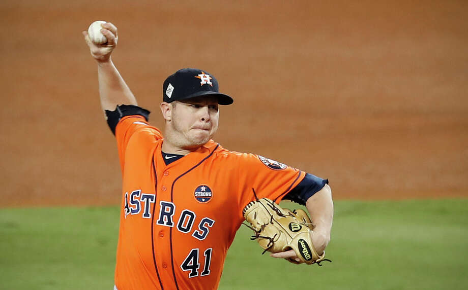 Brad Peacock will likely compete with Collin McHugh for a rotation spot during spring training but Astros manager A.J. Hinch says Peacock can fill a lot of roles. Photo: Brett Coomer, Staff / © 2017 Houston Chronicle