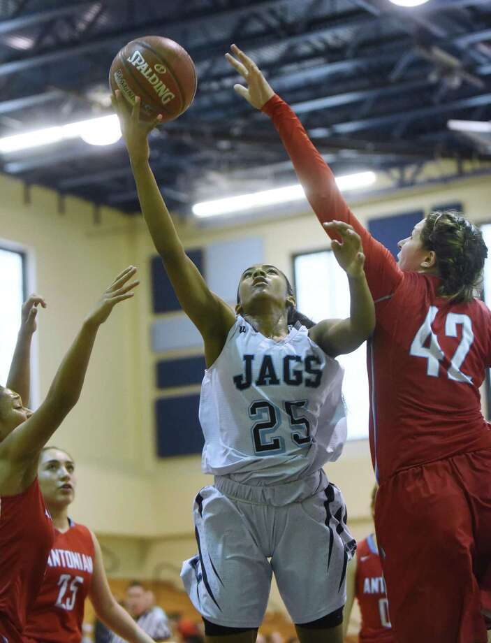 Deja Kelly (25) of Johnson shoots a layup as Kelly Simmons of Antonian (42) defends during girls high school basketball action at Johnson High on Saturday, Dec. 16, 2017. Photo: Billy Calzada, Staff / San Antonio Express-News