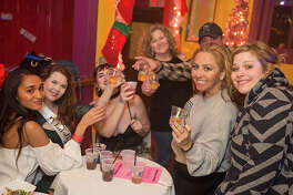 Partiers got in the holiday mood during The Bonham Exchange's annual Red & White Bash, Friday, Dec. 15, 2017.