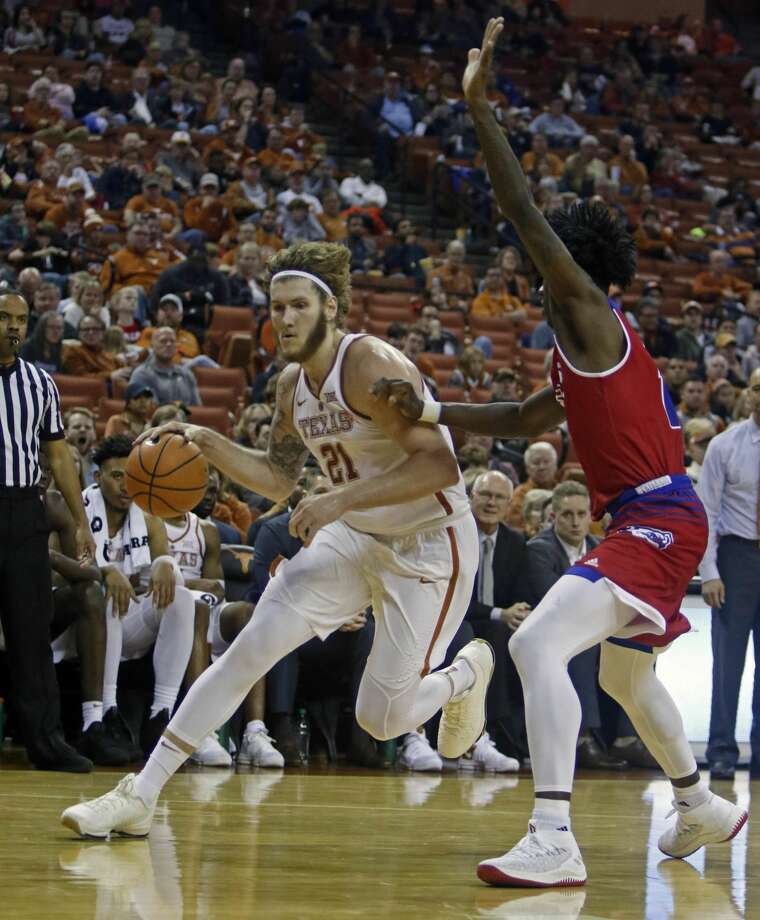 Texas forward Dylan Osetkowski (21) drives to the basket against Louisiana Tech forward Anthony Duruji during the second half of an NCAA college basketball game, Saturday, Dec. 16, 2017, in Austin, Texas. Texas won 75-60. (AP Photo/Michael Thomas) Photo: Michael Thomas/Associated Press