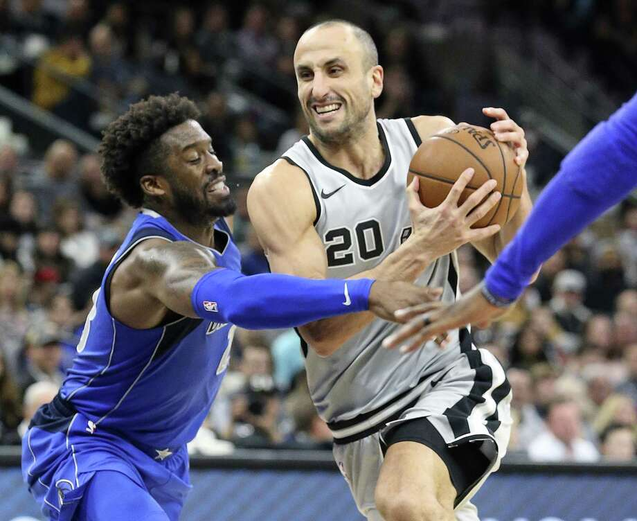 Wesley Matthews tries to get the ball away from a driving Manu Ginobili as the Spurs host the Mavs at the AT&T Center on December 16, 2017 Photo: Tom Reel,  Staff / San Antonio Express-News / 2017 SAN ANTONIO EXPRESS-NEWS