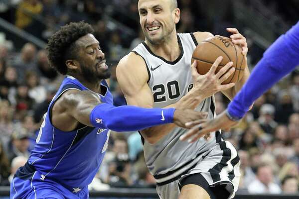 Wesley Matthews tries to get the ball away from a driving Manu Ginobili as the Spurs host the Mavs at the AT&T Center on December 16, 2017