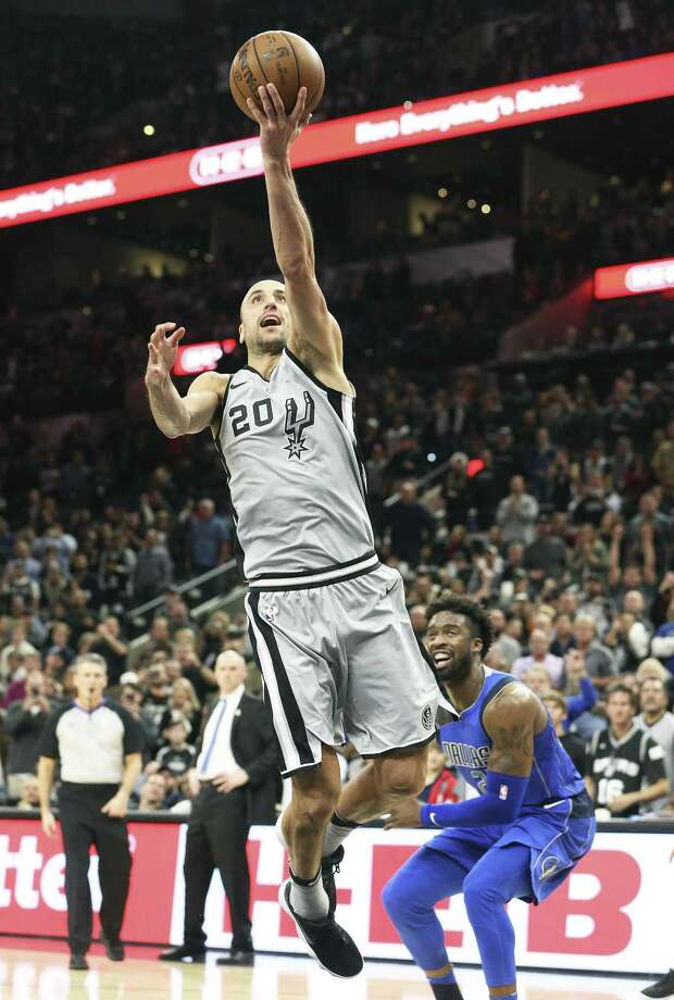 Manu Ginobili gets by Wesley Matthews for a game winning layup as the Spurs host the Mavs at the AT&T Center on December 16, 2017 Photo: Tom Reel, Staff / San Antonio Express-News / 2017 SAN ANTONIO EXPRESS-NEWS