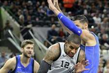 LaMarcus Aldridge squeezes into the lane against Salah Mejri  as the Spurs host the Mavs at the AT&T Center on December 16, 2017