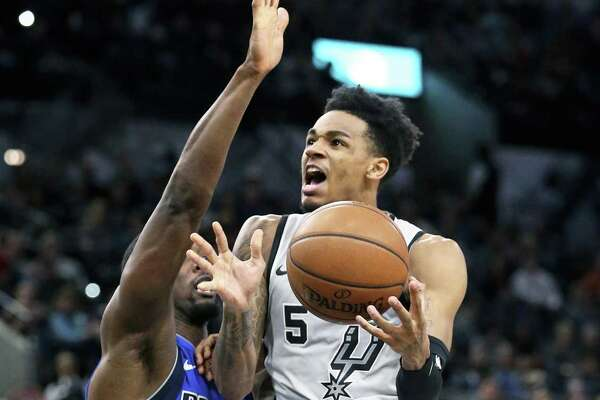 Dejounte Murray glides in for two against Harrison Barnes in the first half as the Spurs host the Mavs at the AT&T Center on December 16, 2017