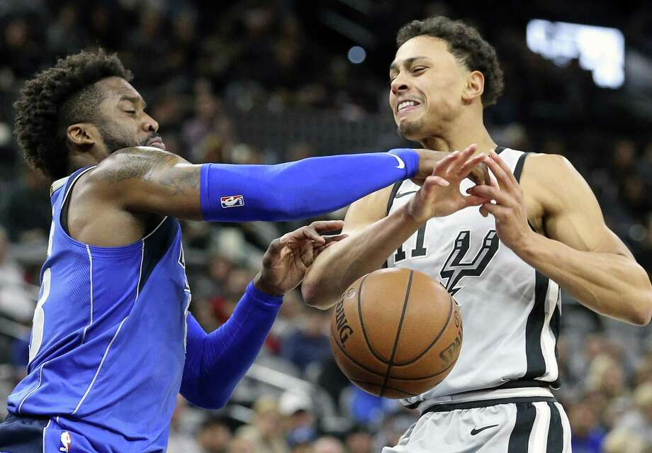 Wesley Matthews reaches in to foil a runner in the lane by Bryn Forbes as the Spurs host the Mavs at the AT&T Center on December 16, 2017 Photo: Tom Reel, Staff / San Antonio Express-News / 2017 SAN ANTONIO EXPRESS-NEWS