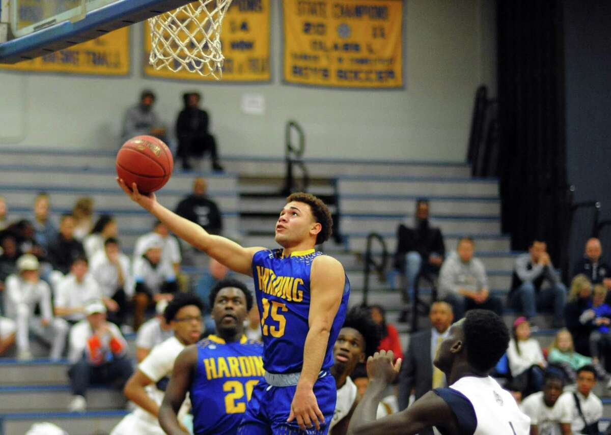 Harding's Josue Rivera Pacheco lays up the ball unopposed during boys basketball action against Notre Dame of Fairfield in Stratford, Conn., on Saturday Dec. 16, 2017.