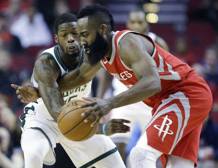 Houston Rockets guard James Harden, right, dribbles as Milwaukee Bucks guard DeAndre Liggins defends during the first half of an NBA basketball game, Saturday, Dec. 16, 2017, in Houston. (AP Photo/Eric Christian Smith) Photo: Eric Christian Smith/Associated Press