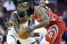 Houston Rockets guard James Harden, right, dribbles as Milwaukee Bucks guard DeAndre Liggins defends during the first half of an NBA basketball game, Saturday, Dec. 16, 2017, in Houston. (AP Photo/Eric Christian Smith)