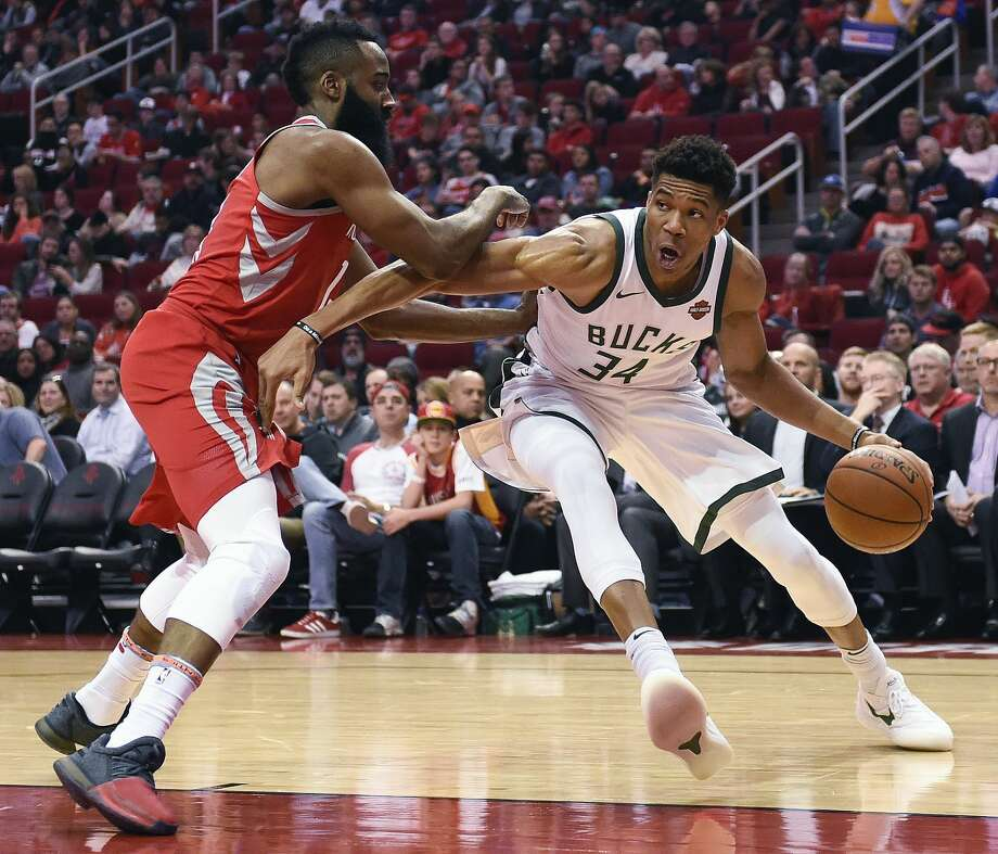 Milwaukee Bucks forward Giannis Antetokounmpo (34) drives as Houston Rockets guard James Harden defends during the first half of an NBA basketball game, Saturday, Dec. 16, 2017, in Houston. (AP Photo/Eric Christian Smith) Photo: Eric Christian Smith/Associated Press