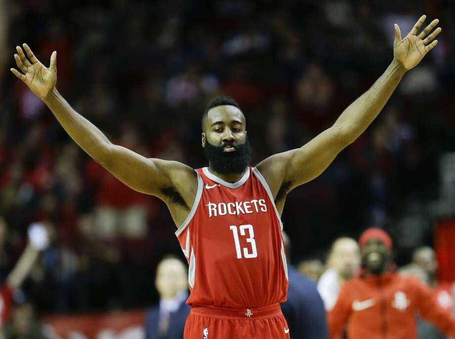 Houston Rockets guard James Harden reacts after a 3-pointer by Chris Paul during the second half of an NBA basketball game, Saturday, Dec. 16, 2017, in Houston. Houston won the game 115-111. (AP Photo/Eric Christian Smith) Photo: Eric Christian Smith/Associated Press