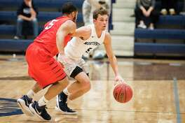 Northwood's Nate Georgeton dribbles down the court, guarded by SVSU's Mike Wells Jr. as Northwood University hosted Saginaw Valley State University on Saturday. SVSU beat Northwood 64-53. (Danielle McGrew Tenbusch/for the Daily News)
