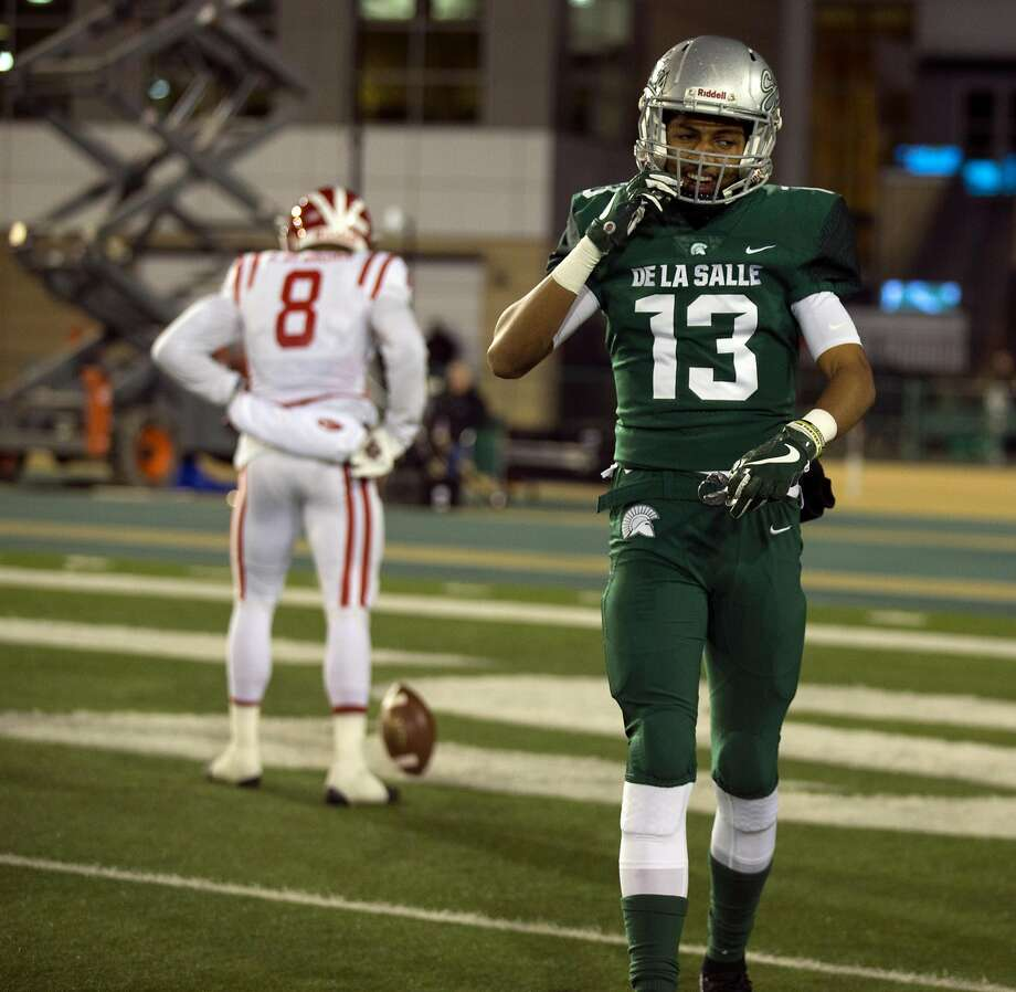 De La Salle�s Taveis Marshall (13) walks back to the bench after allowing a touchdown pass to Mater Dei�s Amon-Ra St. Brown (8) during the first quarter of the Open Division 2017 CIF State Football Championship Bowl Game, on Saturday, Dec. 16, 2017 in Sacramento, Calif. Photo: D. Ross Cameron, Special To The Chronicle