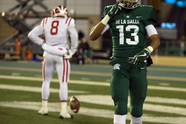 De La Salle�s Taveis Marshall (13) walks back to the bench after allowing a touchdown pass to Mater Dei�s Amon-Ra St. Brown (8) during the first quarter of the Open Division 2017 CIF State Football Championship Bowl Game, on Saturday, Dec. 16, 2017 in Sacramento, Calif.