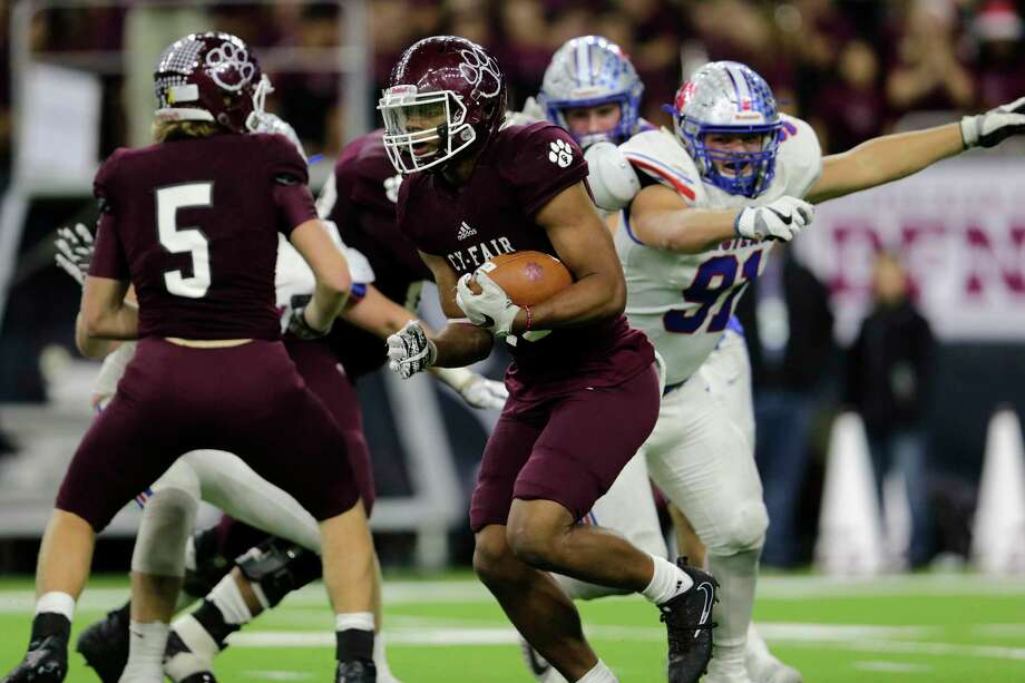 Cy-Fair Bobcats Trenton Kennedy (C) (43) rushes bast Austin Westlake Chaparrals David Neil (91) in the second half during the high school football semifinal playoff playoff game between the Austin Westlake Chaparrals and the Cy-Fair Bobcats at NRG Stadium in Houston, TX on Saturday, December 16, 2017. Photo: Tim Warner, Freelance / Houston Chronicle