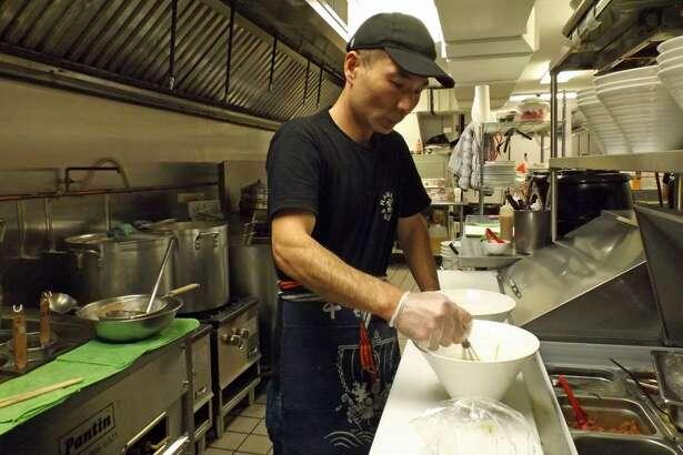 Jackie Chen, head chef at Fujiya Ramen, 425 Main St., Middletown, prepares a ramen dish.